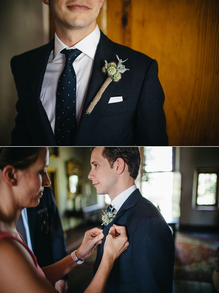 Navy suit. Groom style. Suit with navy tie. Wedding boutonniere