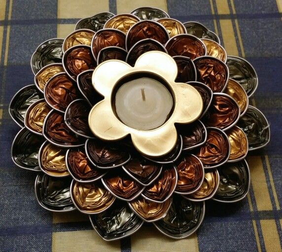 Candle Holder made from Nespresso caps...I'm going to do it this week! it will look great on the coffee table