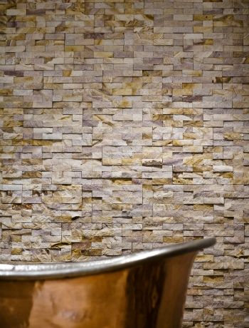 Opt for stone-cladding in favour of tiles for an ultra-sleek bathroom
