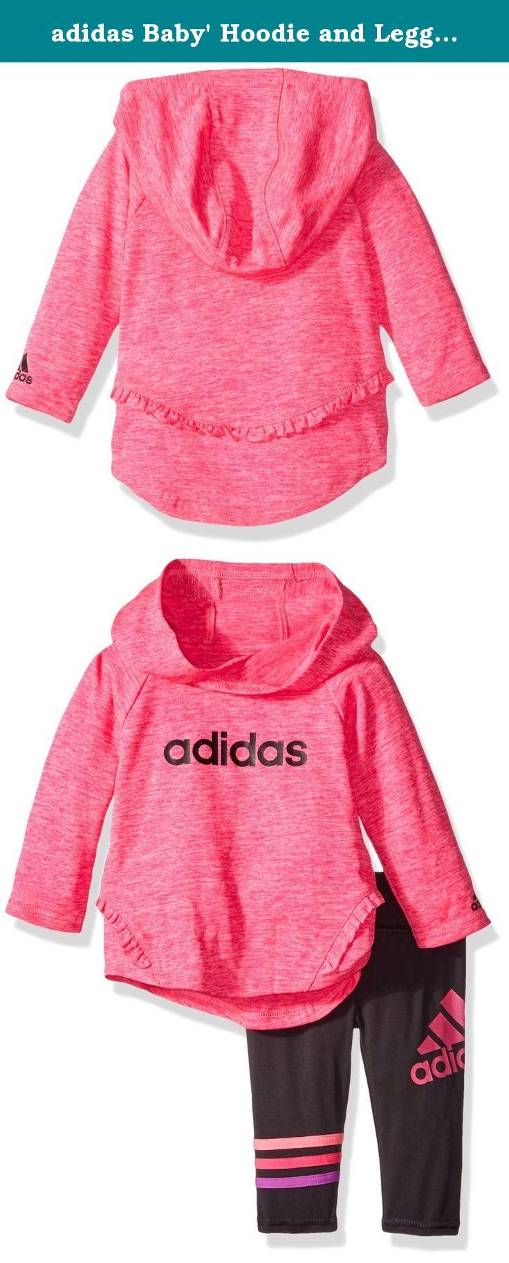 adidas Baby' Hoodie and Legging Set, Shock Pink Heather, 12 Months. The hooded top features angled front seams with ruffle and drop-tail back hem with curved ruffle seam. Black foil screen printed linear Adidas on front. Screen-printed Adidas brand mark on left sleeve. Tight with flat waistband. Applied stripes around right leg and wraparound performance logo on upper left leg.
