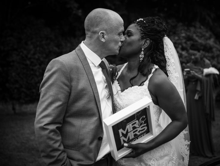 The Bride & Groom kissing.Wedding photography for Abe & Marsha who got married at Oakley House Bromley June 2016