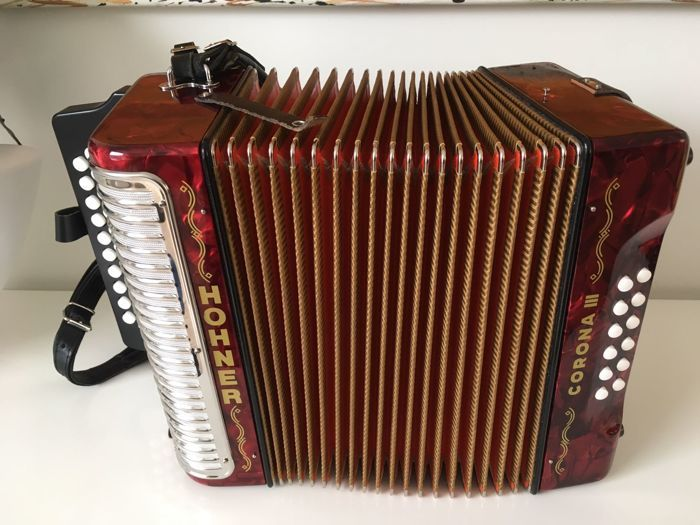 Hohner Corona III GCF Accordion  This Hohner Corona III accordion can be played in 3 keys and has 3 voices in different keys so that you as a musician can take advantage of the great freedom it offers and develop your personal style to the utmost. Includes a comfortable strap. The accordion's finely crafted reeds bellows valves and celluloid-covered wood keyboard are routinely trusted by some of the world's most famous accordion players.Every Hohner accordion is the result of over 100 years…