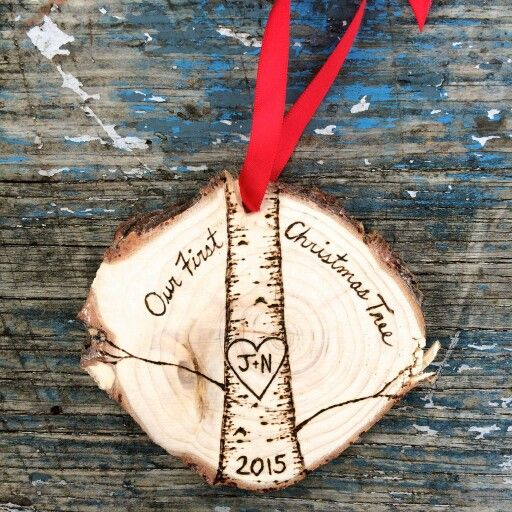 What a cool idea! Before you throw out your tree, cut a slice off the bottom of the trunk, sand it clean and wood-burn it. Turn it into an ornament that you can use forever!