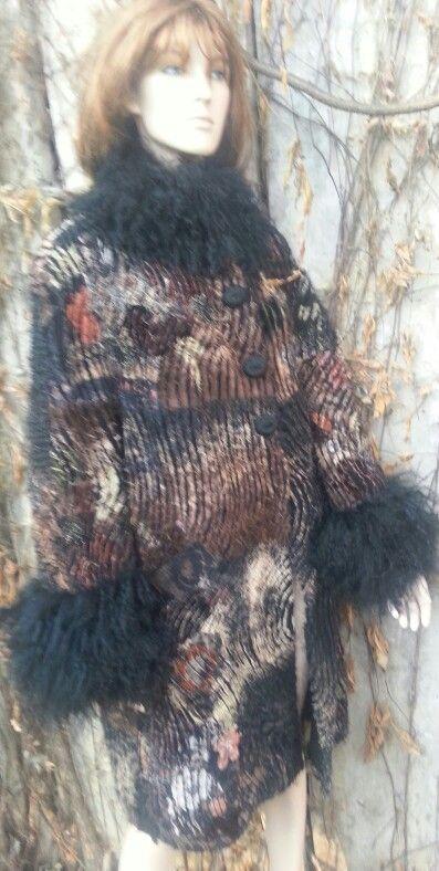 Slashed linen coat by Beata Jarmolowska