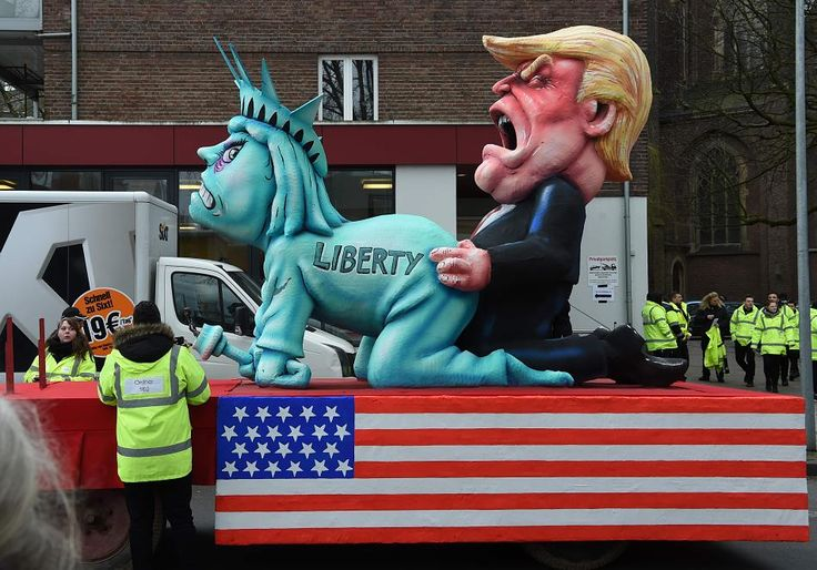 Donald Trump mocked by German Carnival floats: Statue of Liberty ...German Carnivals promoting hate/war mongering for the whole world. And the spectators love it! Wait..?  Weren't the Germans the ones who started WWI and WWII?  What are they trying to tell us now?