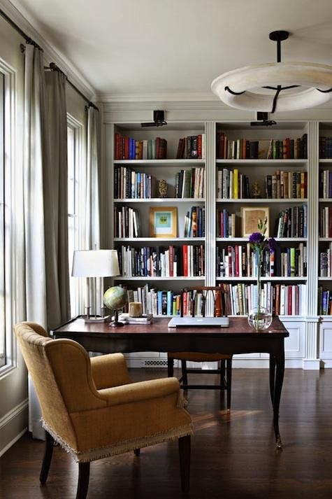 offices-dark-wood-multi-colored-bookcases-books-bookshelves-desks-lounge-chairs : Remodelista