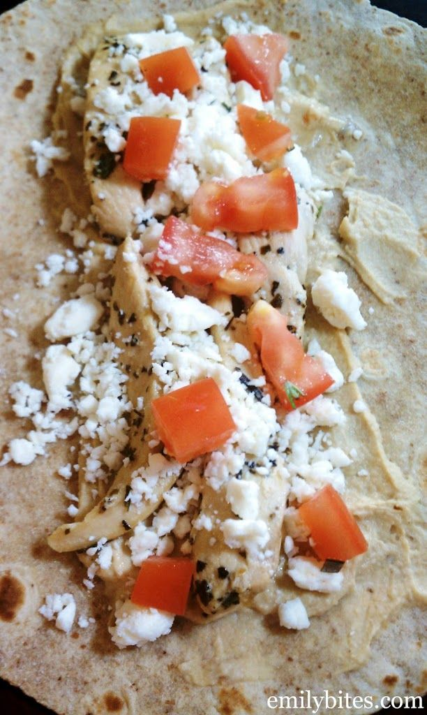 """This may not be the prettiest dish I've ever posted, but oh man, is it delicious. There's a local """"dive"""" restaurant near me that has a wrap with chicken, hummus, Feta and tomatoes and I've been meaning to recreate it at home for a while. Between the strong roasted garlic flavor of the hummus, the …"""