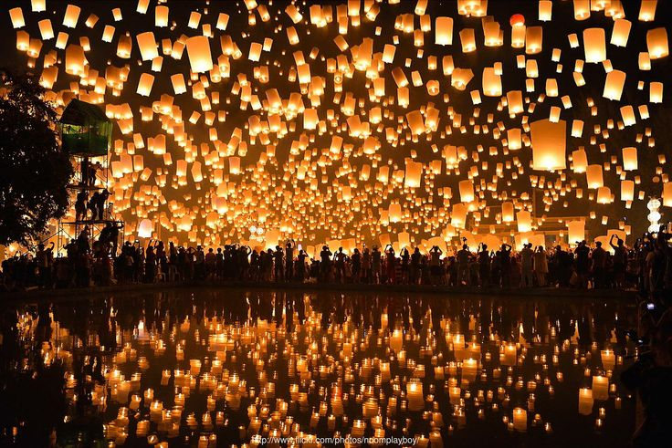 35) watching floating lanterns in the night sky
