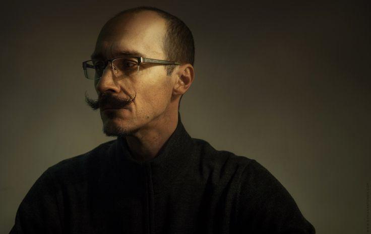 man, portrait, rembrandt light, dark