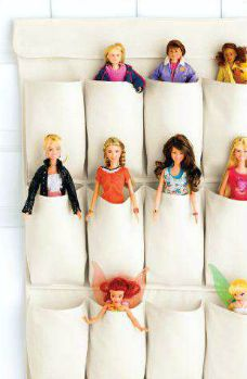 Over the door shoe rack turned barbie storage. Love this idea if we have a little girl.