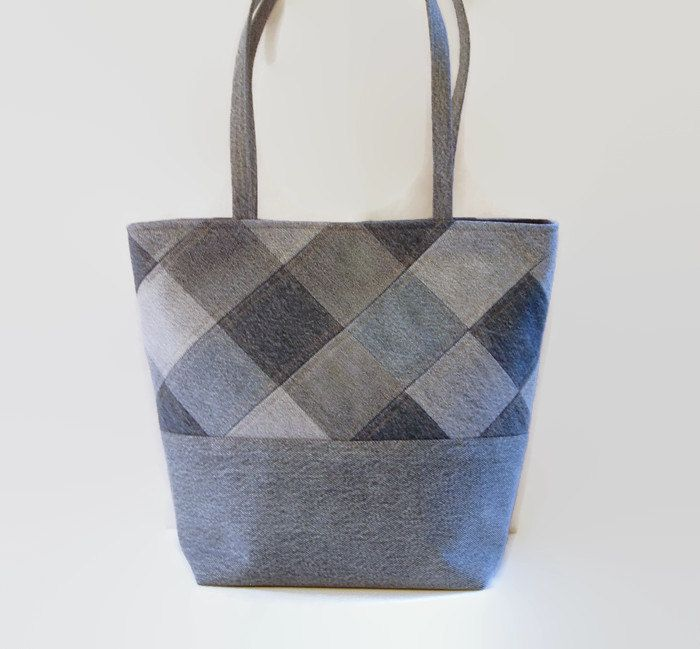 This large tote bag, handbag, purse or shoulder bag is made out of upcycled recycled denim jeans and repurposed cotton fabric. It has ample space to comfortably carry all your daily items and must haves. It is strong and sturdy. Use it as a book bag, carry your magazines or special projects. Add a favorite pin to coordinate with your outfit. The exterior was constructed from a variety of denim jeans, cut into squares, attractively pieced together and top stitched with gold thread. There are…