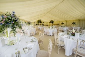 An elegant marquee wedding with place settings