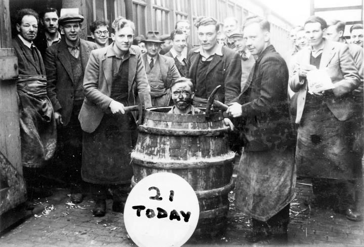 Peter Atkin is pictured here in the barrel being 'trussed in', at the termination of his coopers apprenticeship at Bass Brewery. The young men who are carrying out the ceremony are the three senior apprentices, Gerald Cooper, Reg. Atkin and Derek Rhodes.