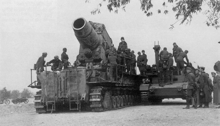 The German giant mortar Mörser Karl Gerät Nr. III to Odin, used against the Soviet fortress of Brest, in the early stages of Operation Barbarossa in June 1941. Beside's the Munitionsschlepper (ammunition loader), PzKpfw IV converted.