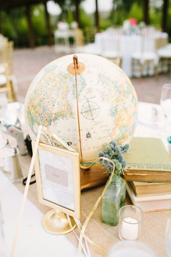 Use globes as centerpieces at a travel themed wedding / http://www.deerpearlflowers.com/travel-themed-wedding-ideas-youll-want-to-steal/2/