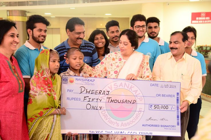 Dheeraj , a 15 year old boy, suffering from #craniopharyngioma receiving a donation from NavSankalp, a student run charity organisation, Chandigarh, India. http://navsankalp.org/category/news/