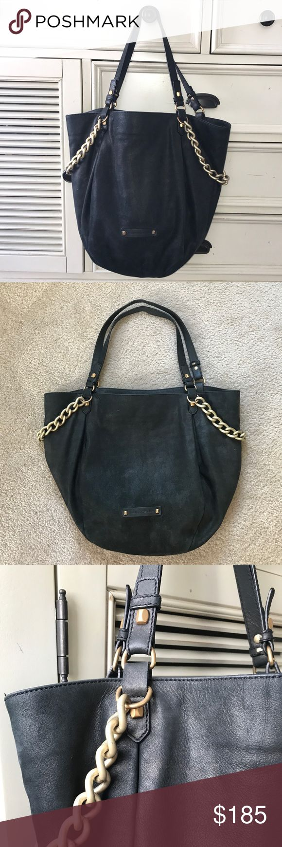 """Francesco Biasia Leather Tote Bag - Black Francesco Biasia Leather Tote Bag. Soft Italian leather with subtle metallic sheen. Gold chain detail on sides. Three inside pockets, one zippered. Shows no wear, I hardly ever used it. Measures 17"""" wide, 14"""" tall with 10"""" drop. Francesco Biasia Bags Totes"""