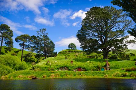 """AUCKLAND TO WAITOMO CAVES & HOBBITON MOVIE SET PRIVATE LUXURY TOURS. Travel from Auckland in luxury to see the world-famous Waitomo Glow worm Caves and continue to the Hobbiton Movie Set made famous by the movie trilogies """"The Lord of the Rings"""" and """"The Hobbit"""". TIME UNLIMITED TOURS."""