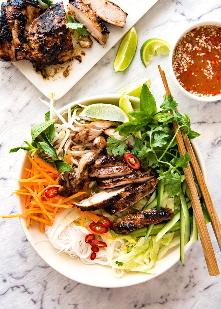 Vietnamese Noodles with Lemongrass Chicken (Bun Ga Nuong) - The popular Vietnamese dish made with Vermicelli noodles topped with fresh vegetables, lemongrass marinated chicken and drizzled with Nuoc Cham. Absolutely lip smackingly delicious! www.recipetineats...