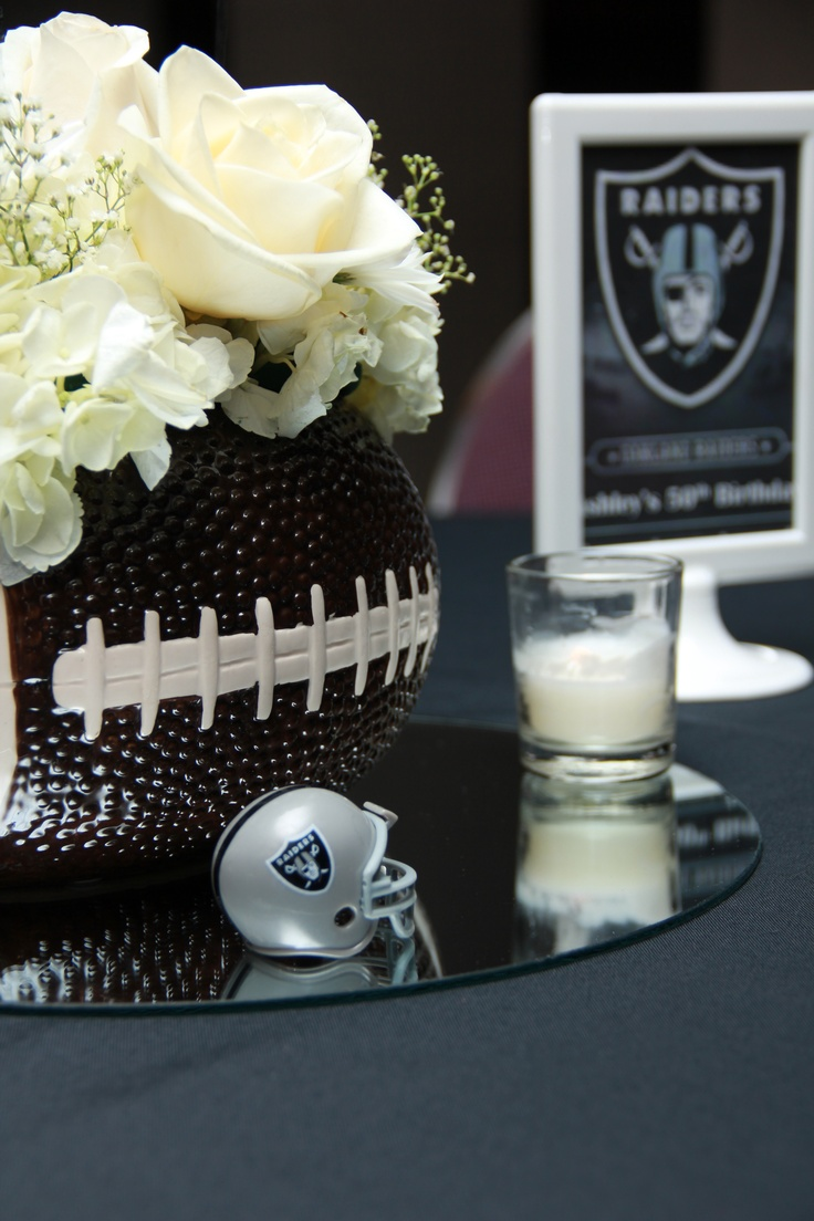 Centerpiece with fresh flowers inside of a football vase. Event by Creating A Remarkable Event. www.careevents.com