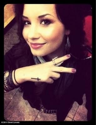 love her cross tattoo!!