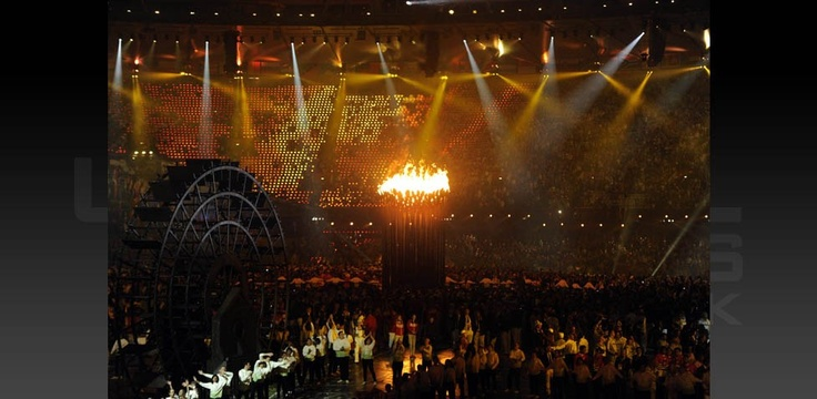 Copper pedals lit by the Olympic Flame converge to form a single torch during the opening ceremony for the 2012 London Olympic Games at Olympic Stadium. (Robert Deutsch-USA Today Sports)