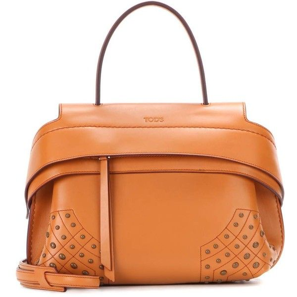Tod's Wave Mini Leather Tote (£1,435) ❤ liked on Polyvore featuring bags, handbags, tote bags, orange, handbag tote, leather totes, leather handbags, leather tote handbags and mini tote