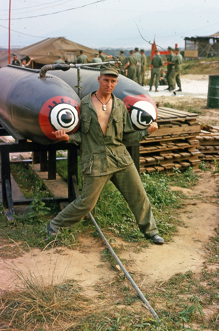 Dennis R Decker, 3rd Marine Division 3rd Recon Charlie Company in Vietnam hamming it up at base camp in Da Nang with make shift water tanks.