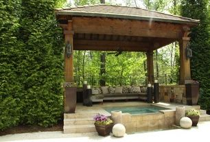 "Craftsman Hot Tub with Crate and Barrel Bronze 26.5"" Tall Tapered Planter, exterior stone floors, Gazebo, Fence"