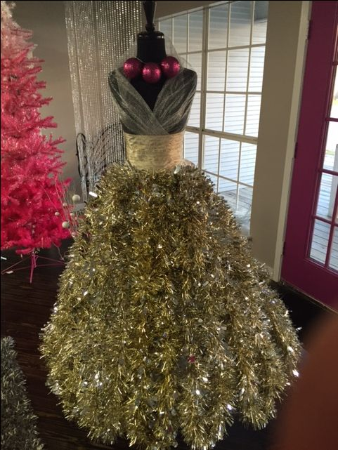 Designed by Arlean M. at Amore Dress Boutique in Houston, Texas  Nice to see a Dress Form Xmas Tree with gold instead of green garland.