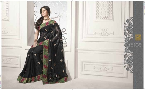 Black Georgette designer saree, The Saree is black georgette with self work  The blouse is black and there is a red and green border along the saree.   £129.99