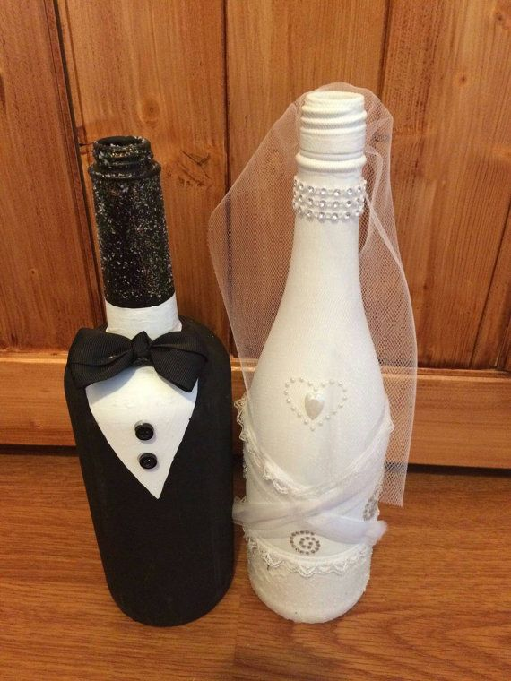 Check out this item in my Etsy shop https://www.etsy.com/listing/290078633/bride-and-groom-wine-bottles