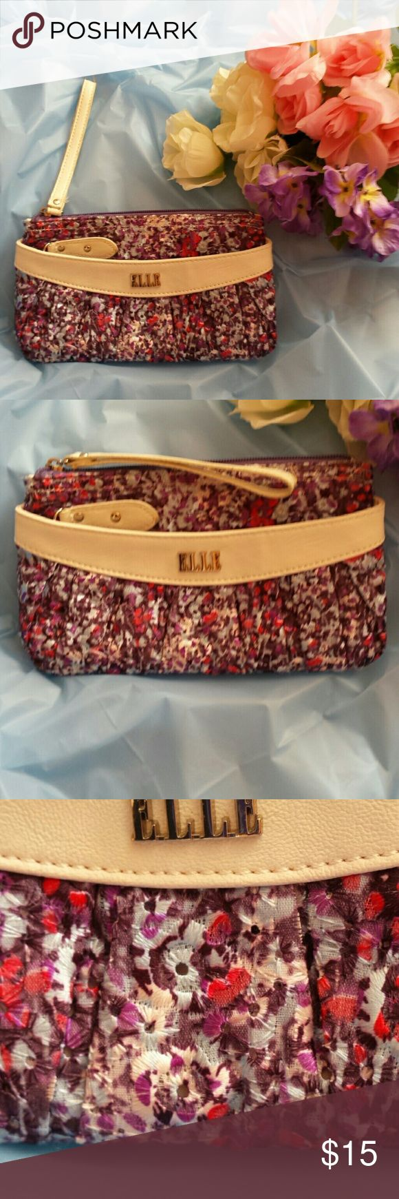 Elle Wristlet Pretty Elle wristlet with one zip pocket on the front and one pocket on the back. Pretty dappled print flowers in colors of purple, hot pink, ivory and mauve. Inside is another zip pocket, a second non zip pocket and 6 slots for credit cards and IDs. Brand new without tags. Elle Bags Clutches & Wristlets