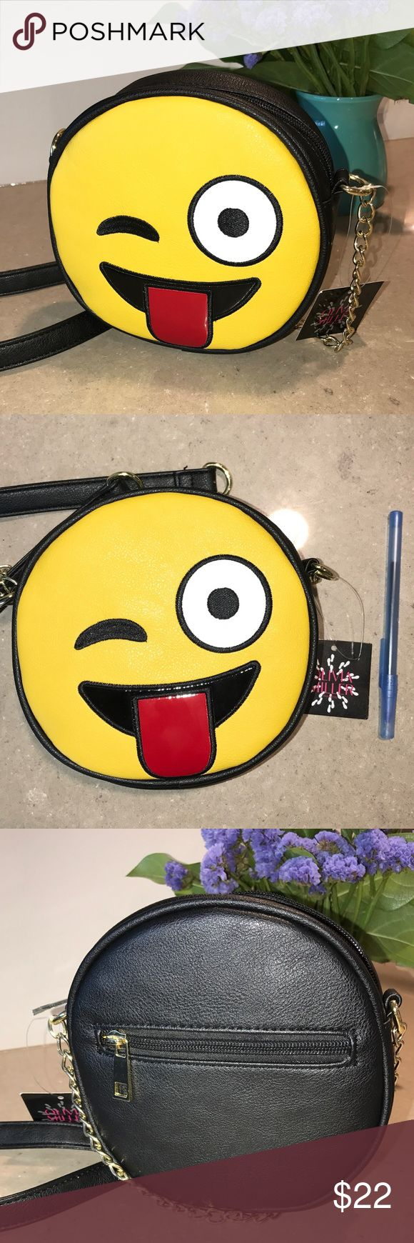 NWT Olivia Miller Emoji Bag Fun and adorable, this bag can be worn cross-body or on one shoulder. One roomy main compartment and one compartment in the back. Pen for scale. Olivia Miller Bags