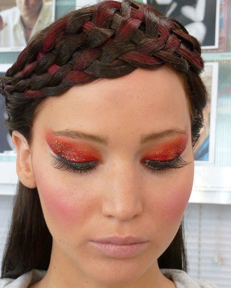 Jennifer Lawrence plays Katniss. Her makeup for the party in the capital at the end of their tour