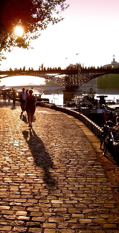 Riverside sunset-Seine bank, Paris. I think this is kind of romantic. People coming home from work, walking down the river. None of that Eiffel Tower crap.