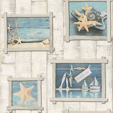 This beige wood panel effect design features framed nautical photos for an authentic feel.