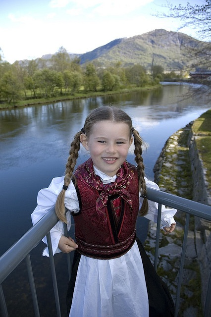 This picture was taken on Norways national day, 17th may. She's wearing our national costume, bunad. The river Jølstra is in the back