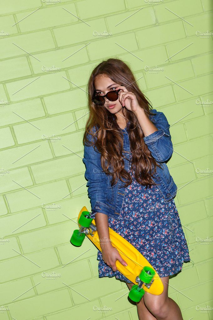 Beautiful hot girl with skateboard. Photos young beautiful long-haired lady in blue dress with yellow plastic penny board skateboard corrects h by nikkolia