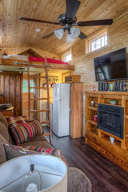 """The Dreamer was listed for $44,900 and came fully furnished, including the electric fireplace, couch, and 48"""" LCD TV."""