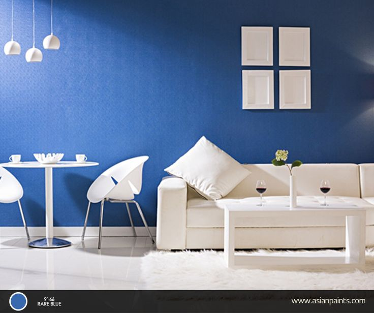 The calming effect of blue and the peacefulness of white can give your room a majestic setting Asian paints interior colour combinations for living room