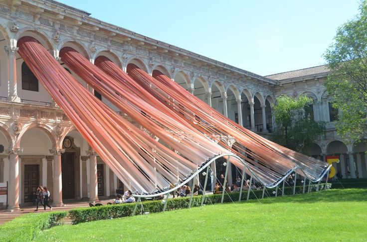 the polymer veil represents an artistic, as well as an architectural gesture, as it follows no functional logic or form, but seems to be shaped by natural elements like the force of the wind or the flow of water.