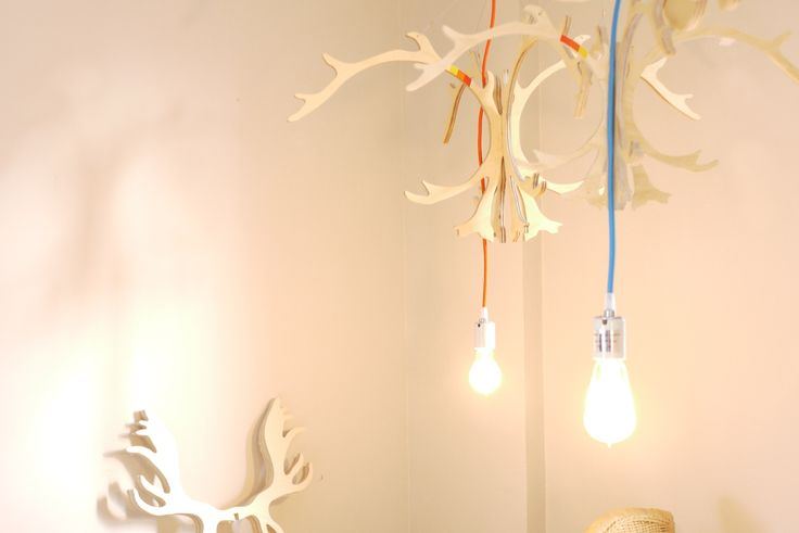 Caribou and moose antler pendant light hanging light fixture with vintage incandescent bulbs on porcelain capped coloured cords. longwkd.com