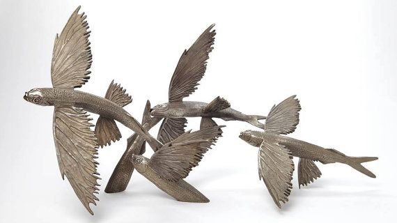 Check out Bronze sculpture grouping of fying fish by Kirk McGuire on kirkmcguiresculpture