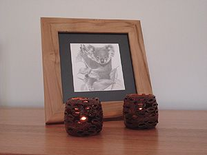 Tea-Light holders made from Banksia Grandis cones. The tea-light sits inside the cone so you can see the flicker of candle light through the open seed pods. Sustainable product as cones are collected under license after the seeds have been shed by the woodworking artist himself. $54.95 http://greengiftsaustralia.com.au/shop/index.php?main_page=product_info&cPath=45&products_id=4