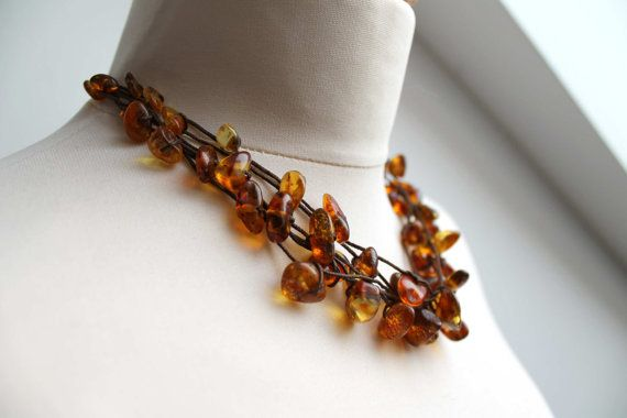 Baltic Amber Necklace Natural Honey Amber Jewelry Multi strand honey baltic amber necklace. Beautiful necklace made of natural baltic amber in fresh honey color and brown cord. So elegant and delicate. Amber button clasps. Total length of necklace open: 49 cm (19.5) but can be made in
