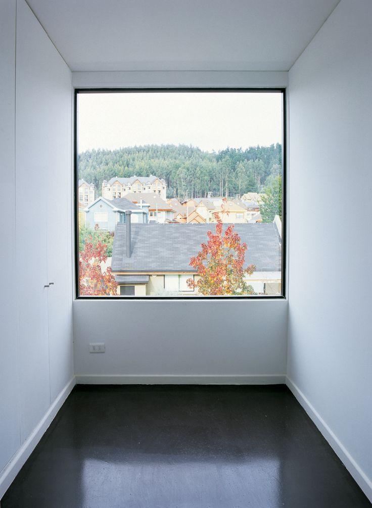 Room wide window inside the Wolf house by Chilean architects Pezo von Ellrichshausen.