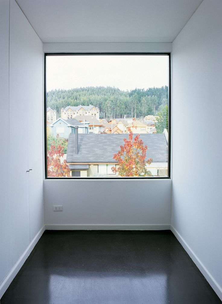 Room wide window inside the Wolf house by Chilean architects Pezo von Ellrichshausen.