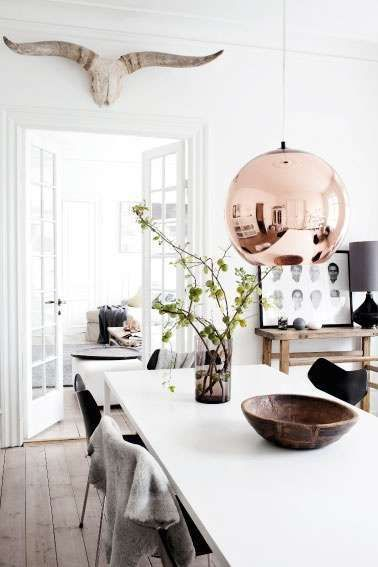 Dining room with large Copper pendant light