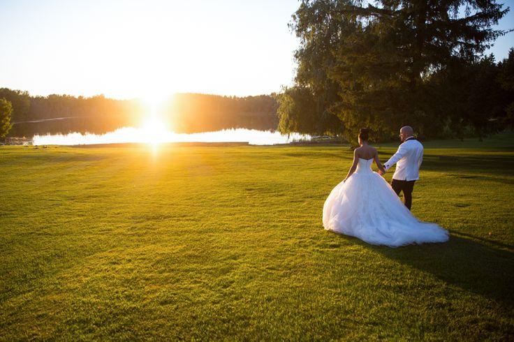 Royal Ambassador bride and groom walking into sunset